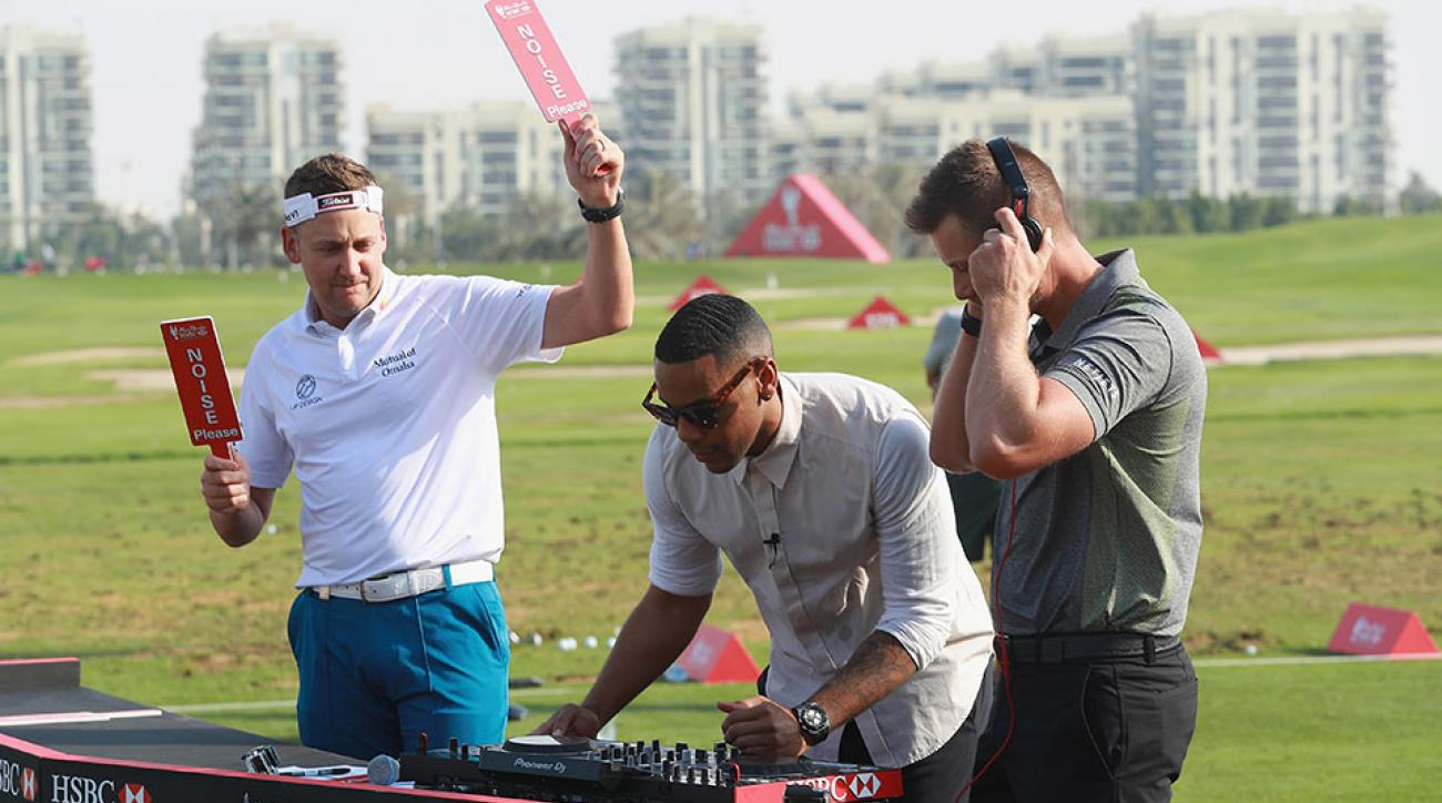 Ian Poulter of England, DJ Reggie Yates and Henrik Stenson of Sweden during a photoshoot on the driving range prior to the Abu Dhabi HSBC Championship.