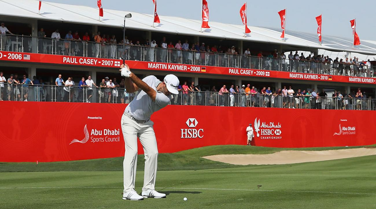 Dustin Johnson of the United States plays his third shot on the 18th hole during the third round of the Abu Dhabi HSBC Championship.
