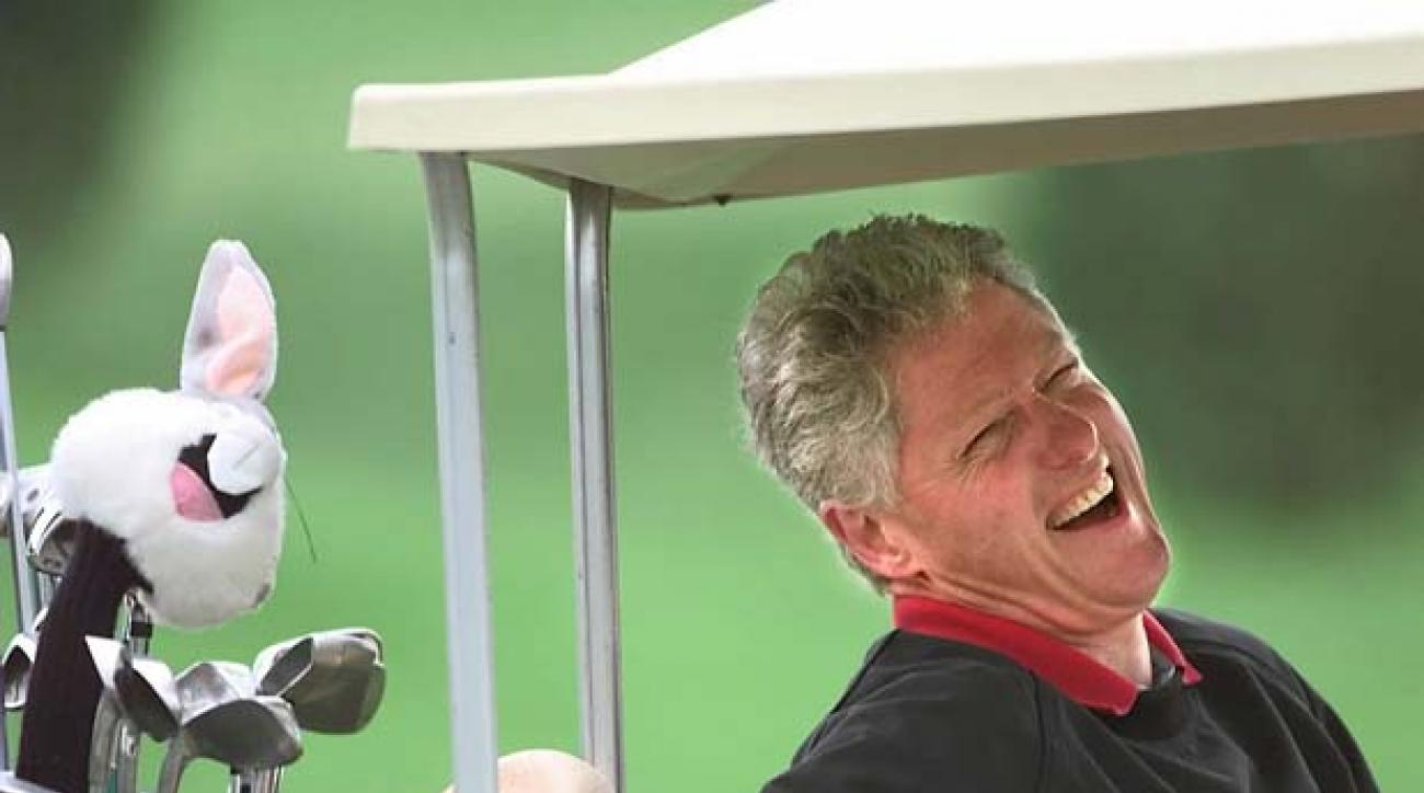 President Clinton laughs as he joins friends for yet another day of golf on Martha' s Vineyard at the Farm Neck Golf Club in Oak Bluffs, Mass., Wednesday, Sept. 3, 1997. The president is relishing his three-week vacation and has been making up for months of lost recreation due to a knee injury earlier this year. (AP Photo/Wilfredo Lee)
