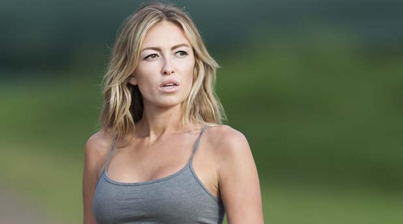 Paulina Gretzky is seen near the 18th fairway during the first round of the Tournament of Champions golf tournament, Friday, Jan. 3, 2014, in Kapalua, Hawaii.  Gretzky is engaged to Dustin Johnson who is playing in the tournament.  (AP Photo/Marco Garcia)