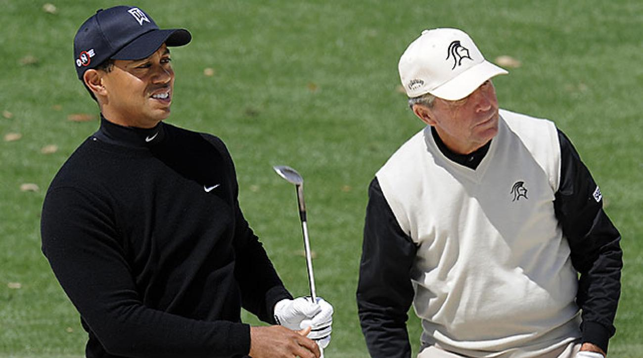 Tiger Woods and Gary Player practice before the 2009 Masters.