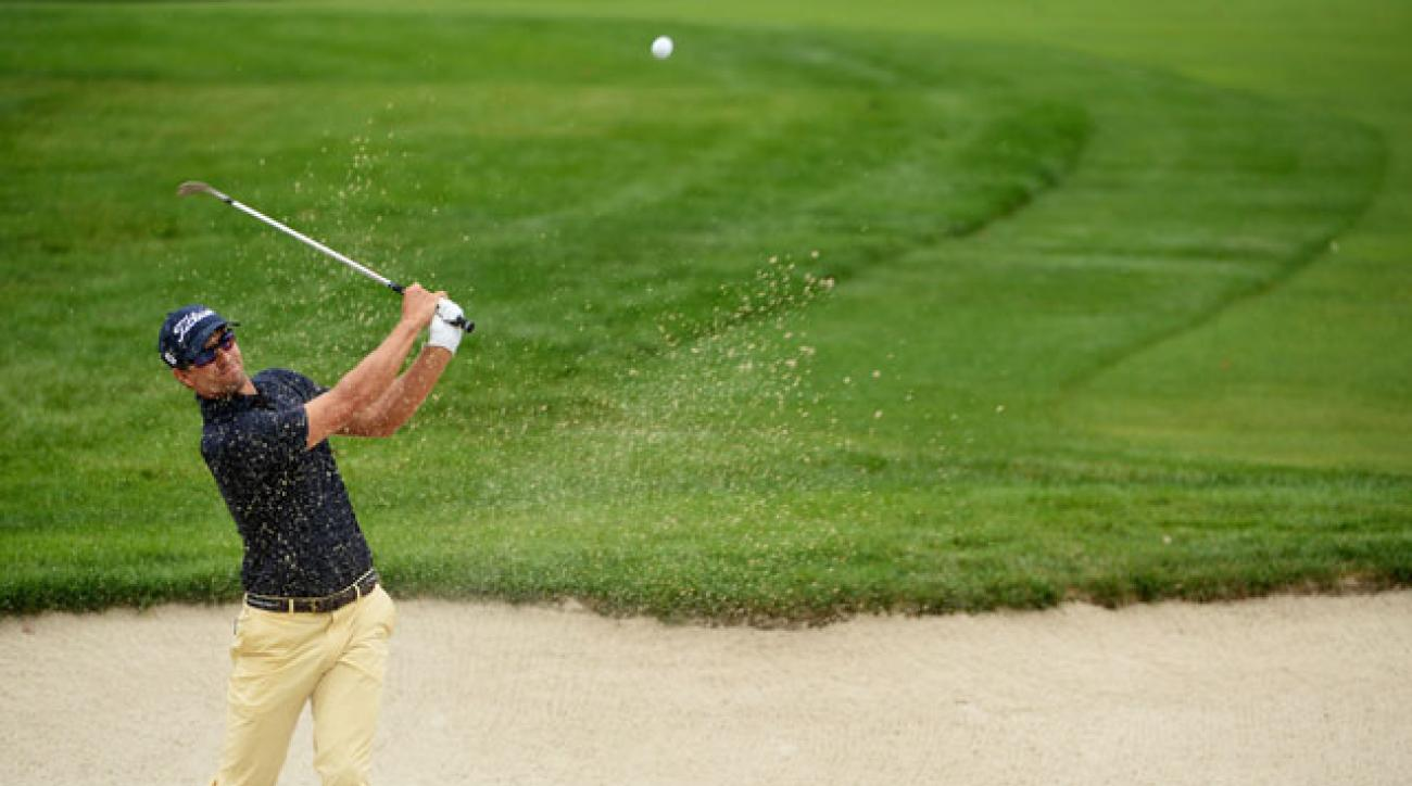 Adam Scott birdied the 18th hole to earn a share of the 36-hole lead at The Barclays.