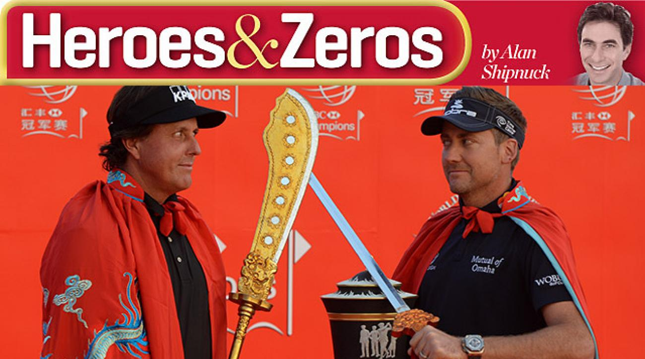2012 WGC-HSBC champion Ian Poulter guards his trophy from 2013 challenger Phil Mickelson. The eyes say it all.