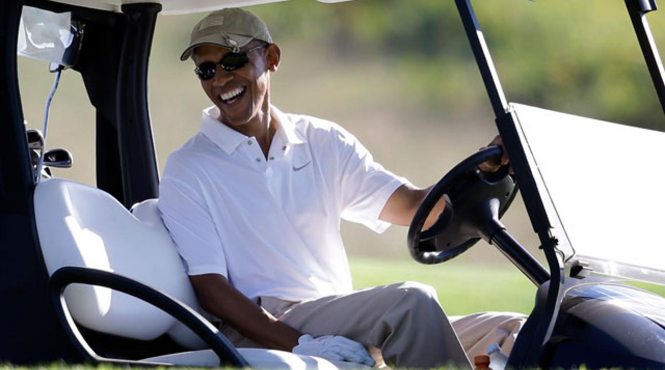 Barack Obama at the wheel of a golf cart at Vineyard Golf Club in Martha's Vineyard.