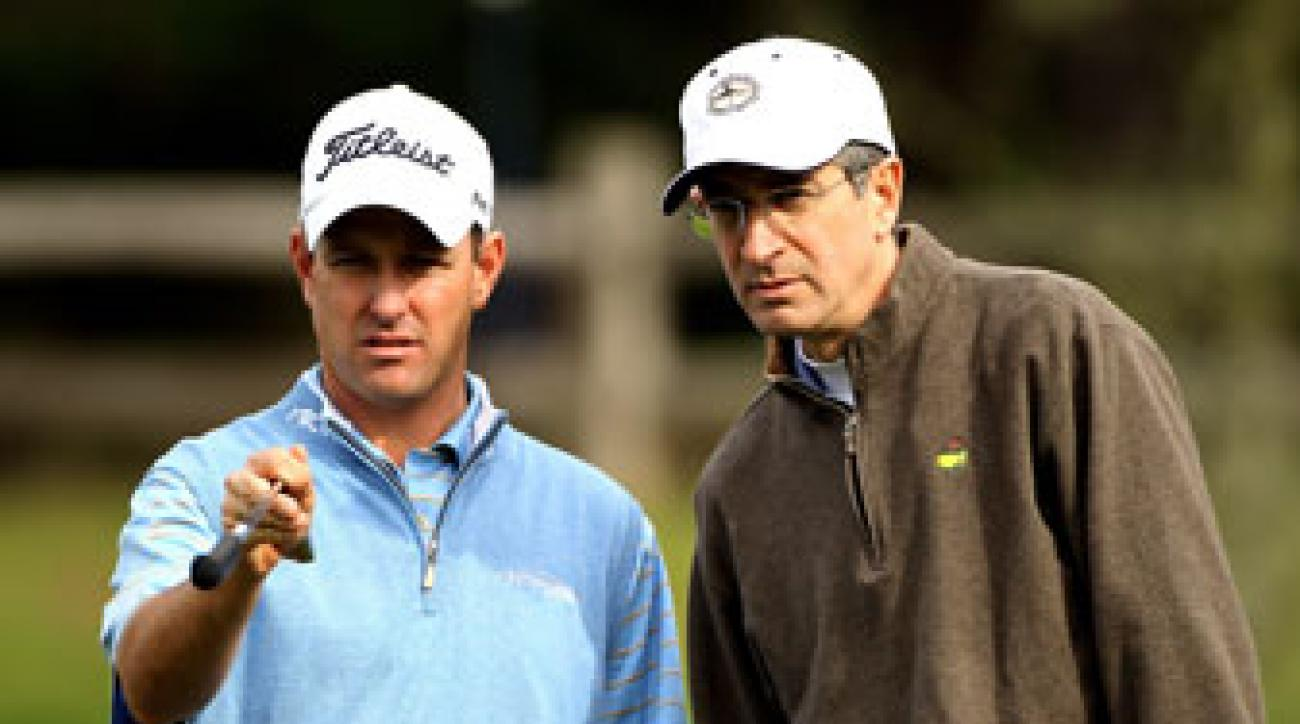 Jeff Klauk (left) speaks to playing partner Brian Roberts during the first round of the AT&T Pebble Beach National Pro-Am at Spyglass Hill Golf Course in 2010.