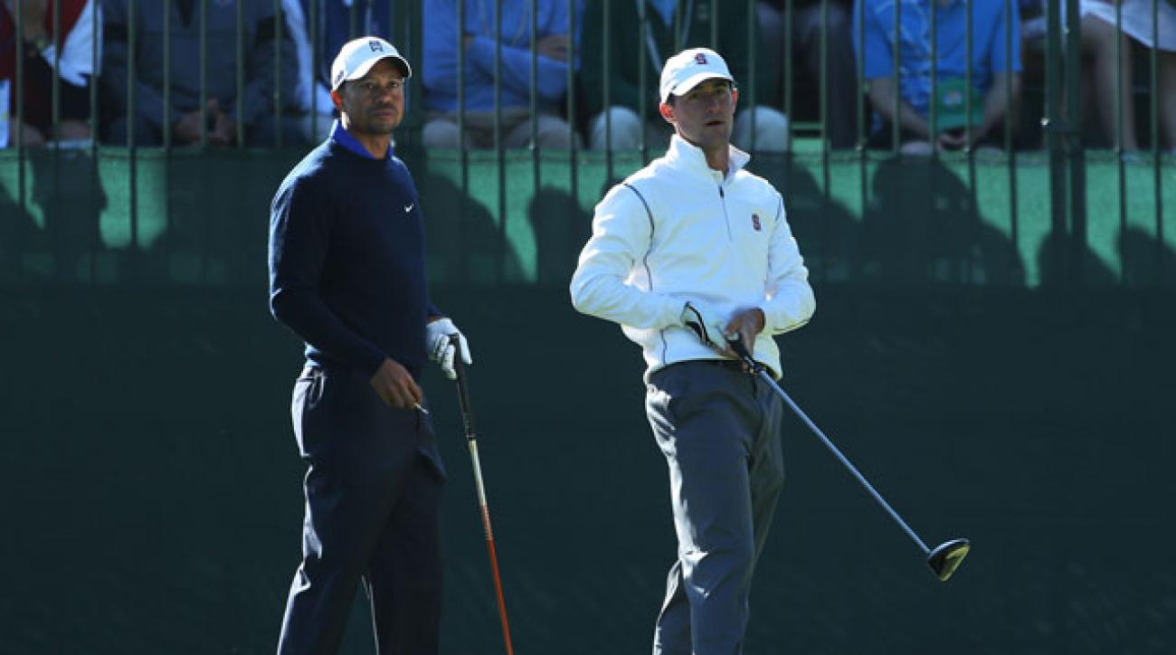 Cameron Wilson watches his tee shot alongside Tiger Woods during a practice round prior to the 2012 U.S. Open at the Olympic Club in San Francisco.