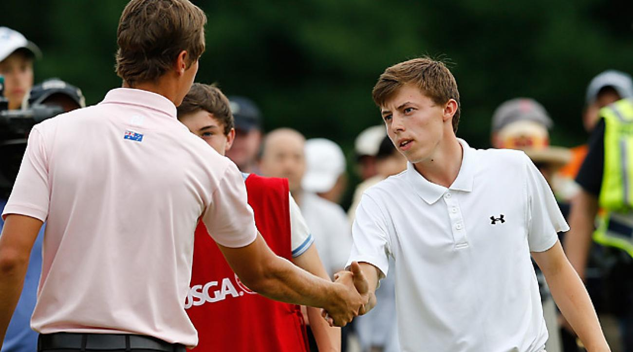 Matt Fitzpatrick of England shakes beat Oliver Goss of Australia at the 2013 U.S. Amateur Championship.