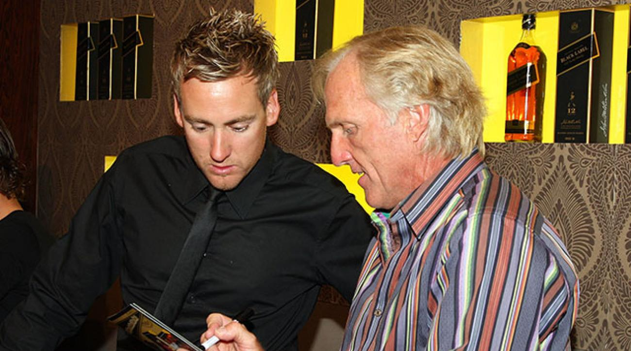 Greg Norman chats with Ian Poulter in 2009.