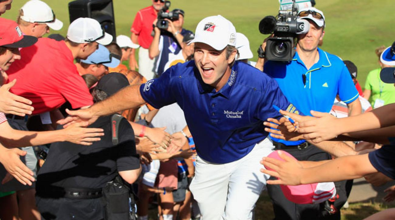 Kevin Streelman celebrates with fans after walking off the 18th green during the final round of the Travelers Championship.