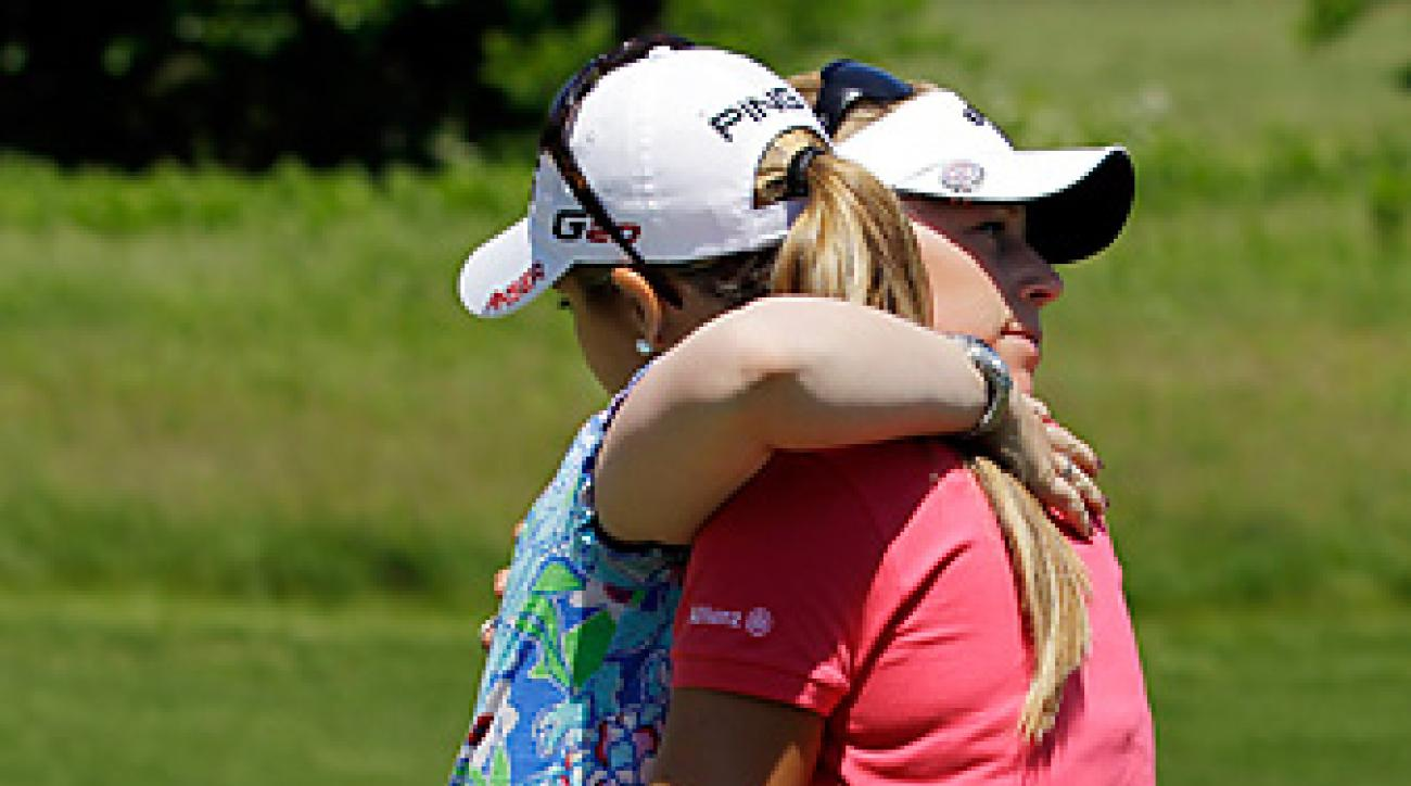 Morgan Pressel and Azahara Munoz shared a quick hug after their tense match.