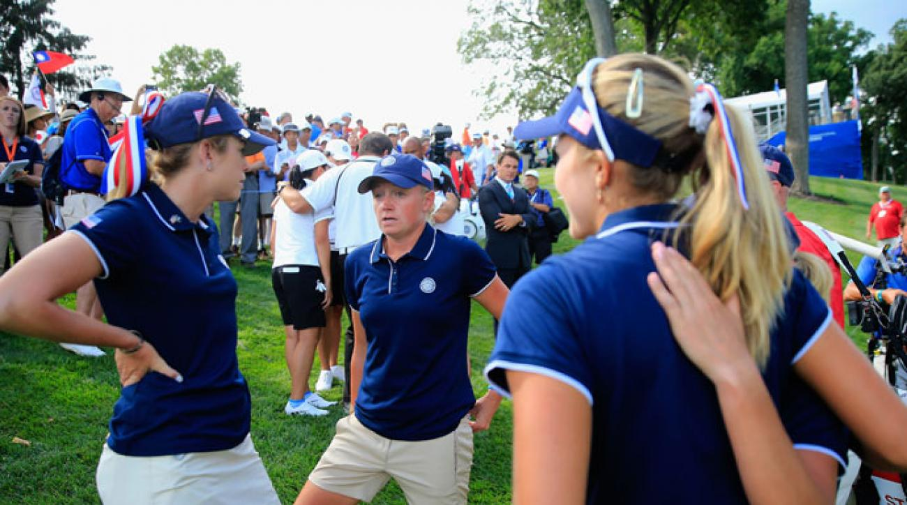 Paula Creamer (left) and Stacy Lewis talk following round one of the International Crown.