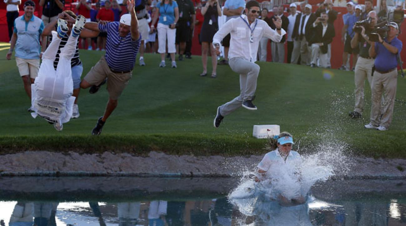 Lexi Thompson takes the traditional winner's leap into Poppy's Pond.