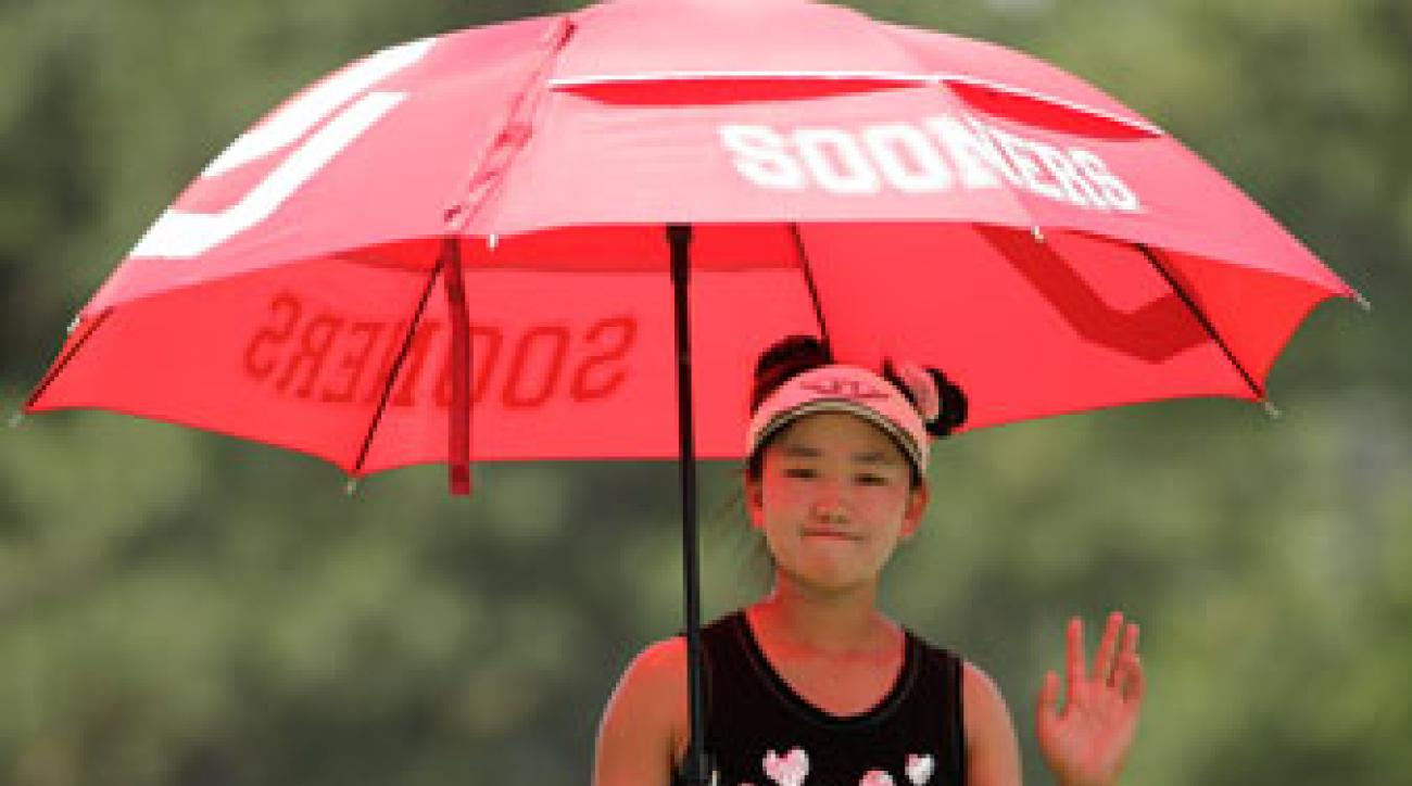 Lucy Li waves to fans during the second round of the U.S. Women's Open.