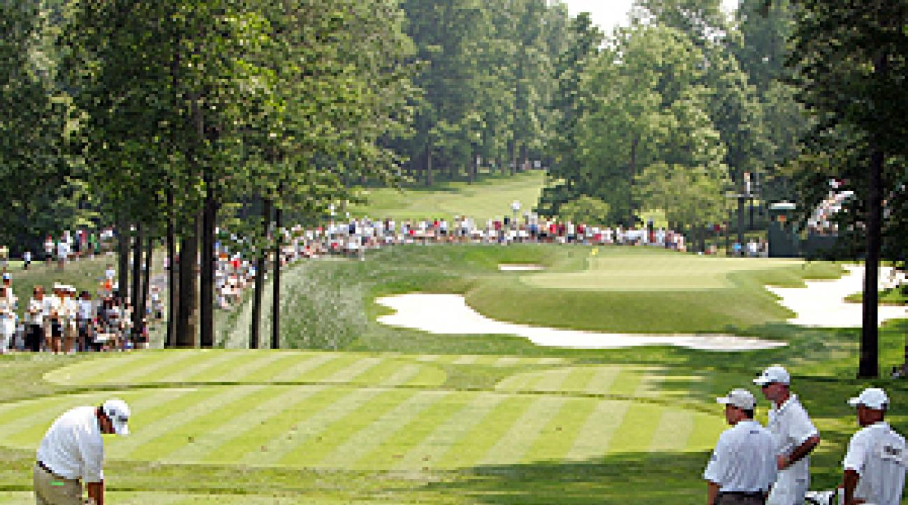 Complete with white jumpsuits on the caddies, No. 8 at Muirfield Village looks a lot like No. 4 at Augusta National.