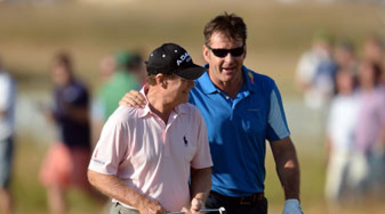 Tom Watson and Nick Faldo walk down the 18th fairway during the second round of the Open Championship at Muirfield last July.