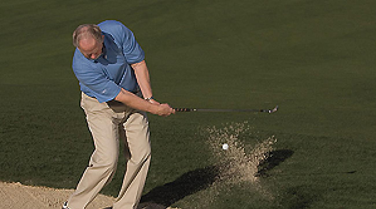 Your club should scoot past the ball after impact from the sand.