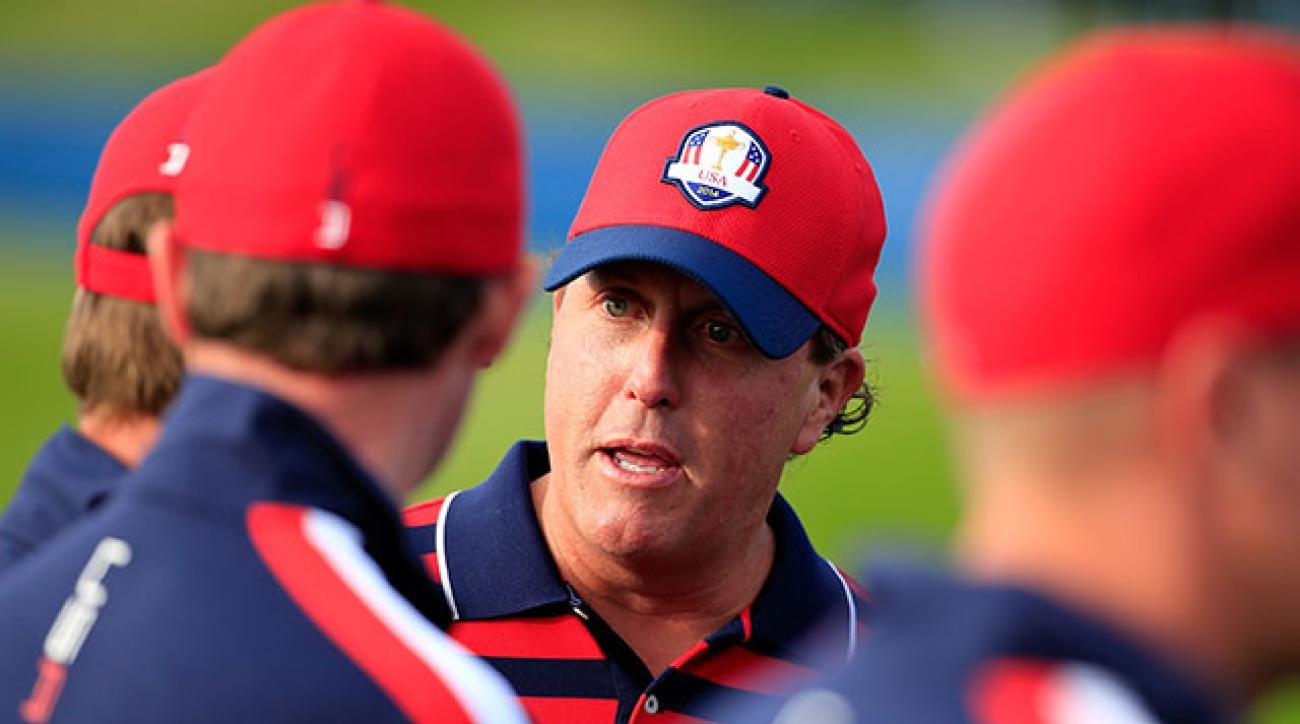 Phil Mickelson chats with his teammates prior to the start of the 2014 Ryder Cup at Gleneagles.