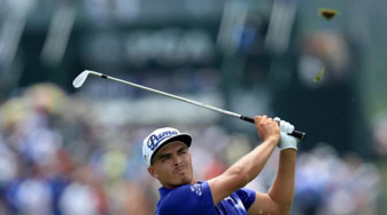 Rickie Fowler hits a shot during the third round of the PGA Championship on Saturday.