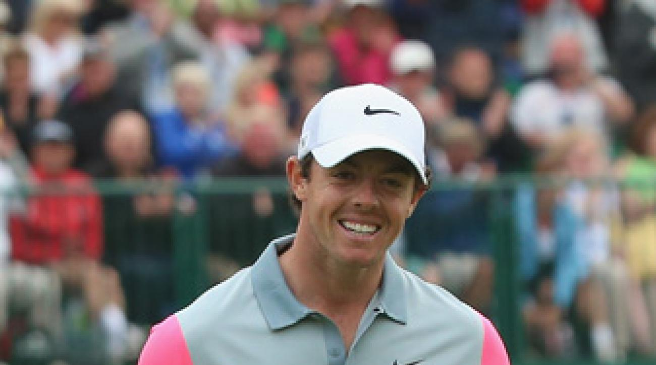 Rory McIlroy celebrates his two-shot victory at the British Open.