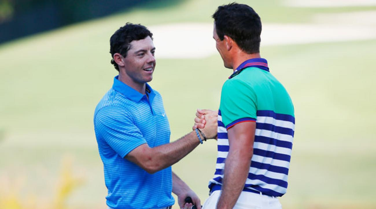 Rory McIlroy and Billy Horschel shake hands on the 18th green following the third round of the Tour Championship at East Lake.