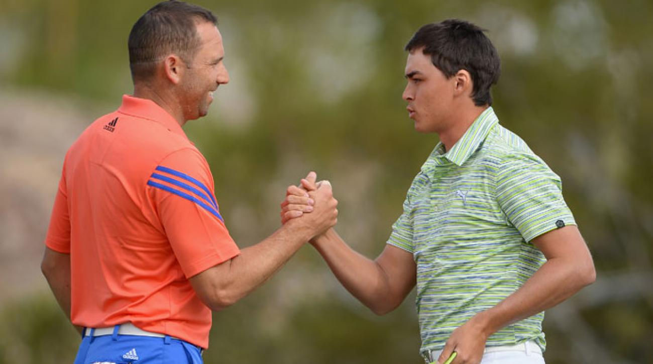 Sergio Garcia congratulates Rickie Fowler following their match.