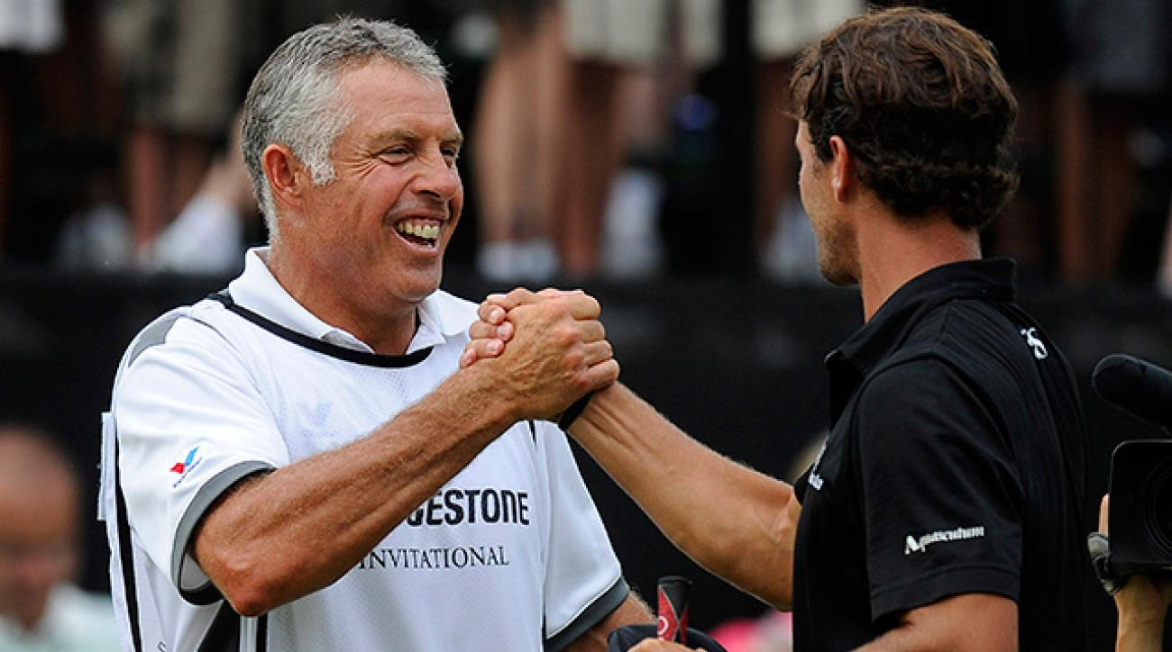 Steve Williams and Adam Scott celebrate Scott's victory at the 2011 WGC-Bridgestone.