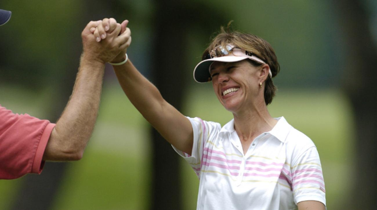Suzy Whaley celebrates a hole-in-one at the 2004 McDonald's LPGA Championship.