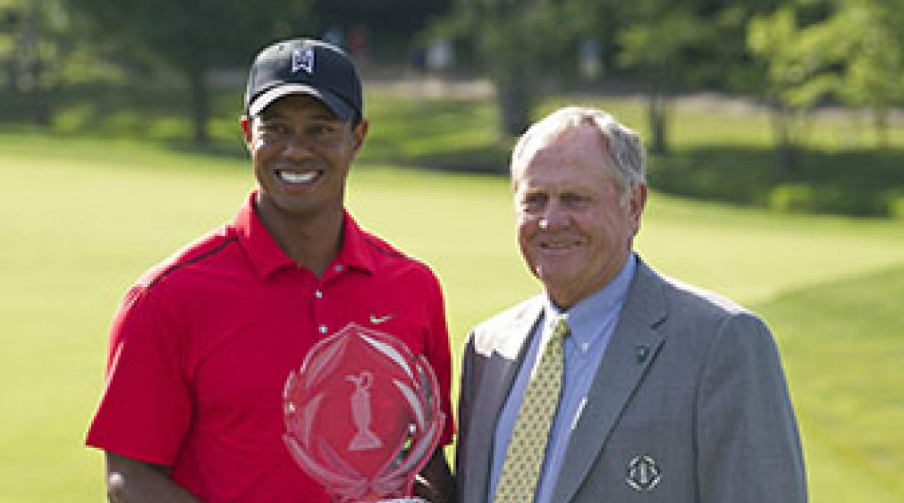 Tournament host Jack Nicklaus joined Tiger after he won the 2012 Memorial Tournament.