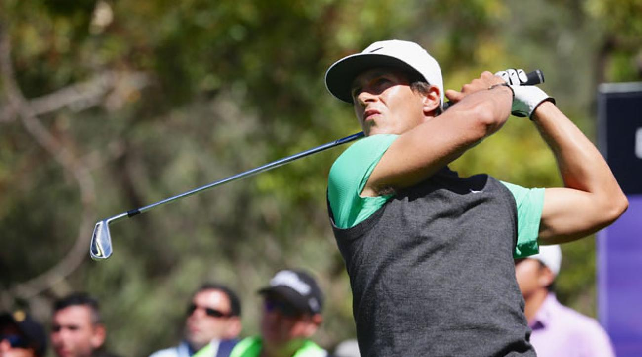 Thorbjorn Olesen held off a hard-charging Victor Dubuisson to win the ISPS HANDA Perth International.
