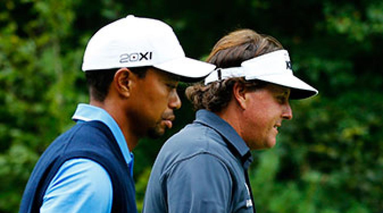 Tiger Woods and Phil Mickelson at the 2013 Deutsche Bank Championship. Woods has not played since undergoing back surgery on March 31, while Mickelson has missed four cuts in 2014.
