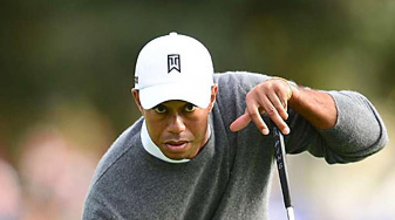Tiger Woods leads by six shots with 11 left to play on Monday afternoon.