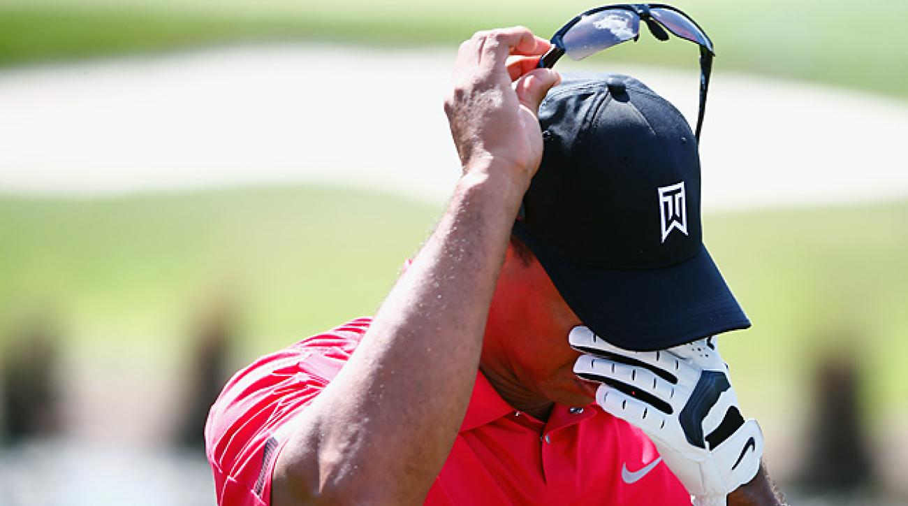 Tiger Woods reportedly told PGA Tour officials that he was suffering from a bad back.