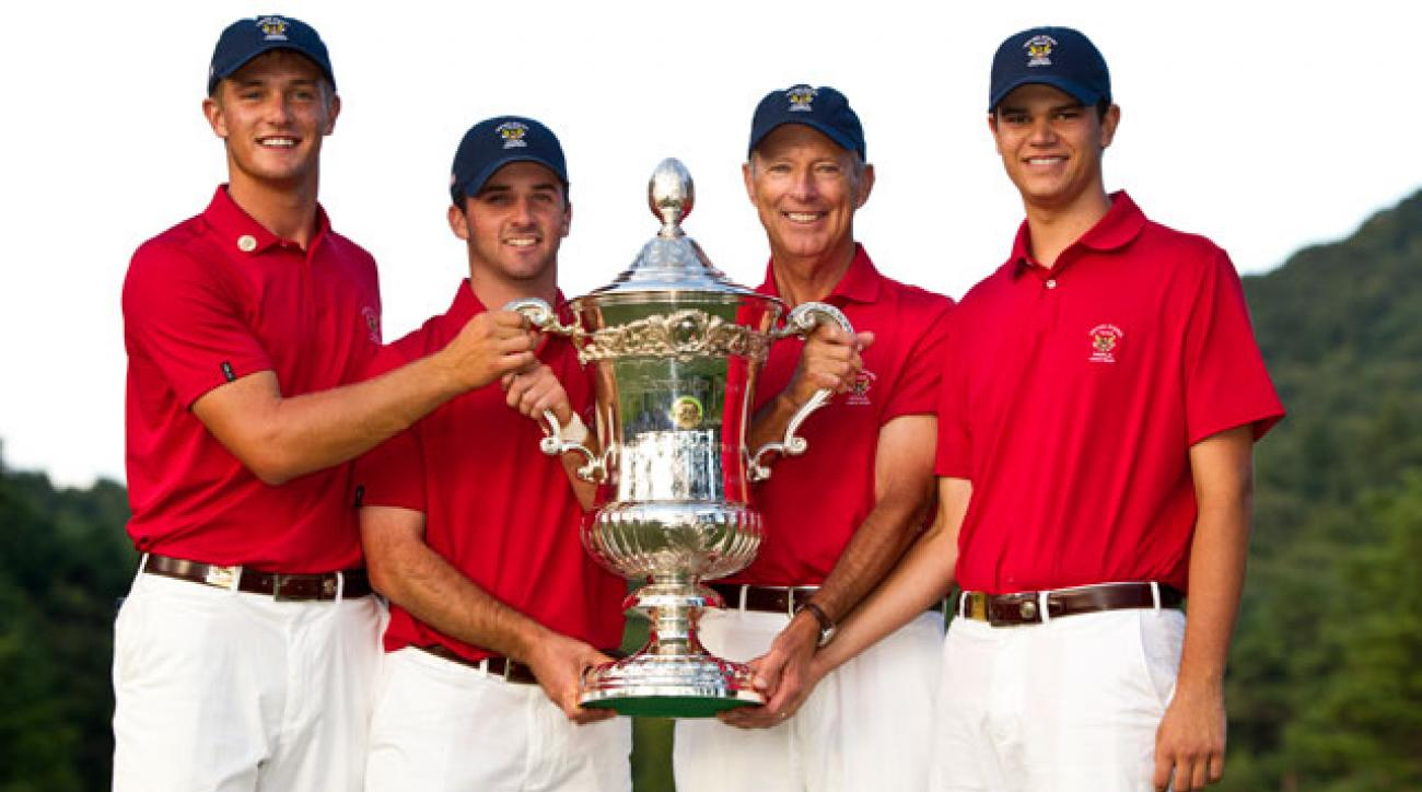 Bryson DeChambeau, Denny McCarthy, Jim Hyler and Beau Hossler hoist the Eisenhower Trophy following their World Amateur Team Championship victory.
