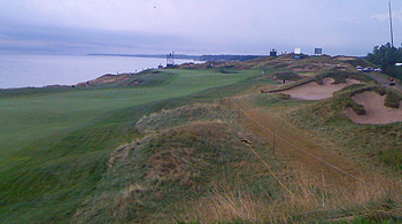 To get close to the action, fans at Whistling Straits needs to walk carefully over wet, grassy mounds like these on the second hole.