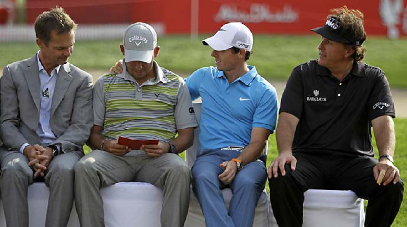 A gracious Rory McIlroy congratulates Abu Dhabi winner Pablo Larrazabal as Phil Mickelson looks on.