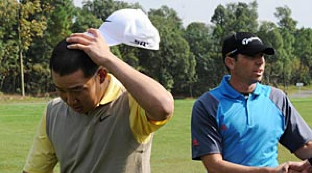 Anthony Kim, left, and Sergio Garcia after Kim was disqualified on Sunday.