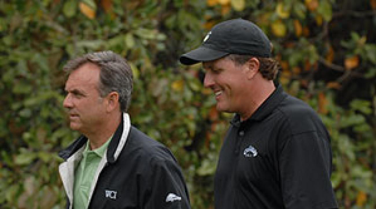 Phil Mickelson with his coach, Rick Smith, at Augusta National on the Sunday before the Masters.