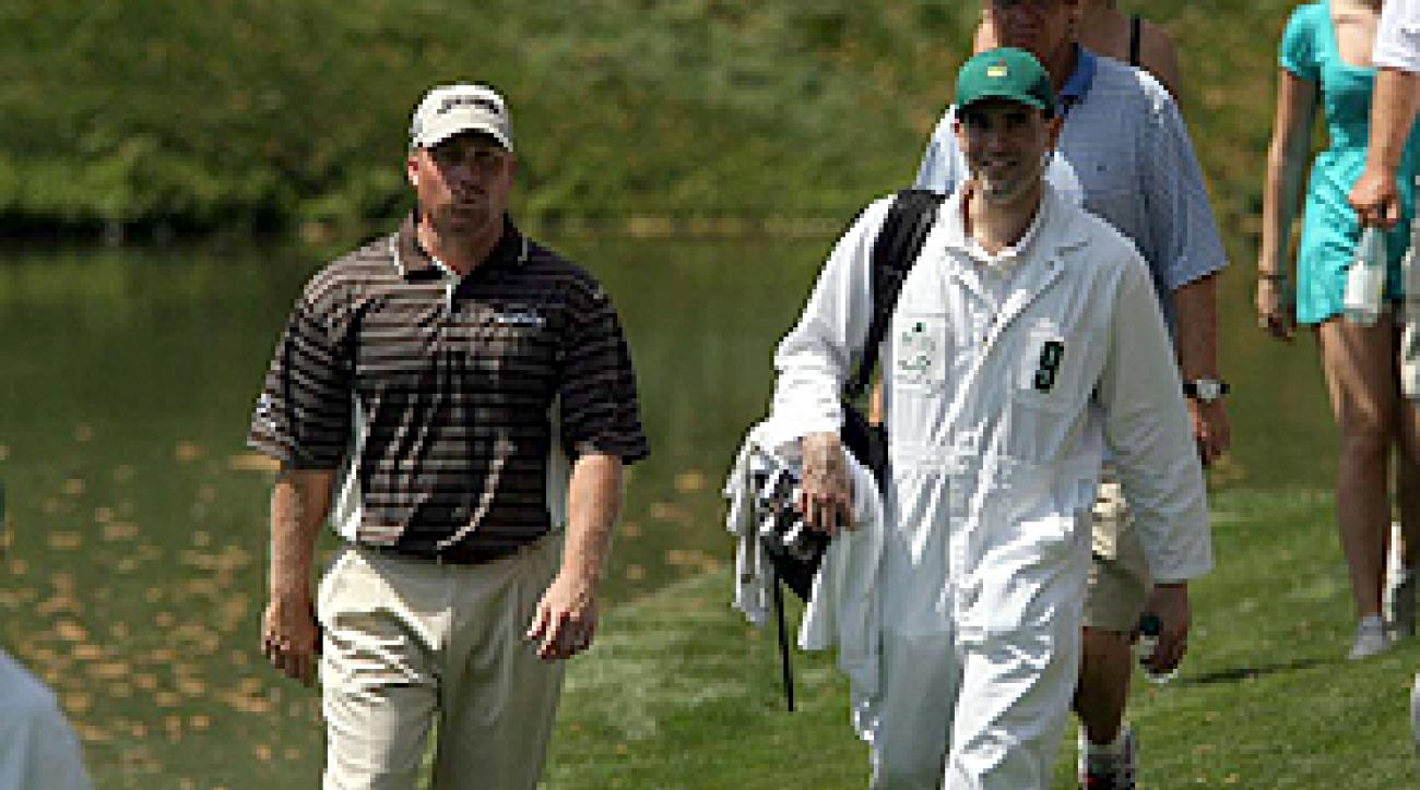 Sports Illustrated's Seth Davis caddied for John Rollins during Wednesday's par-3 contest.