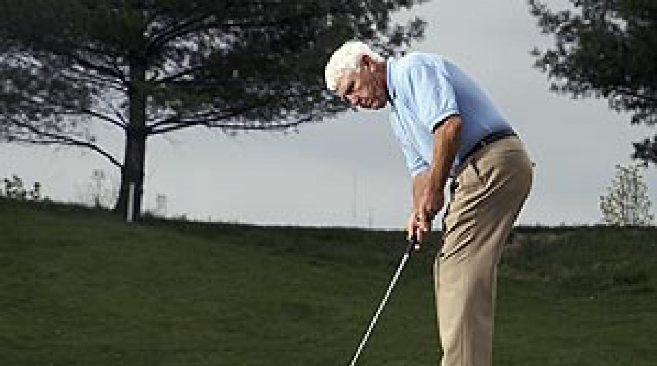 """Determine the """"speed spot"""" (the point where the putt really picks up speed as it travels downhill) and make it your target."""