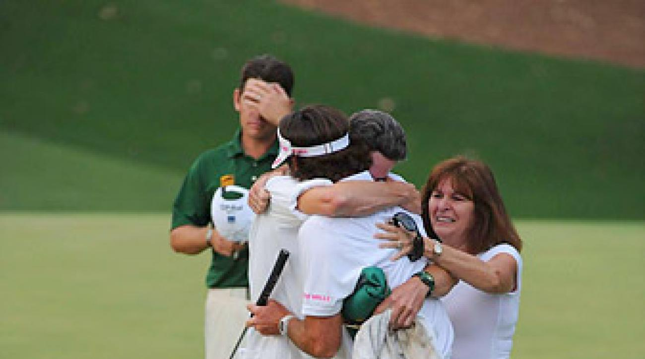 Watson worked his way through a virtual conga line of hug buddies before turning to Oosthuizen.