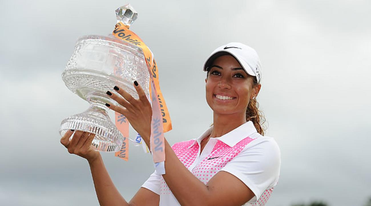 Cheyenne Woods holds the winners trophy after day four of the 2014 Ladies Masters at Royal Pines Resort on the Gold Coast of Australia.