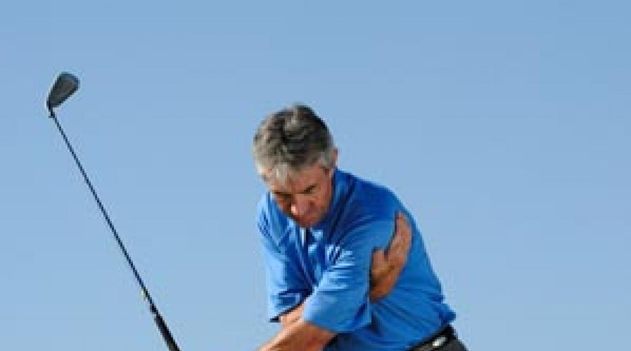Hold your left side back to sync up your downswing and stop pulls.