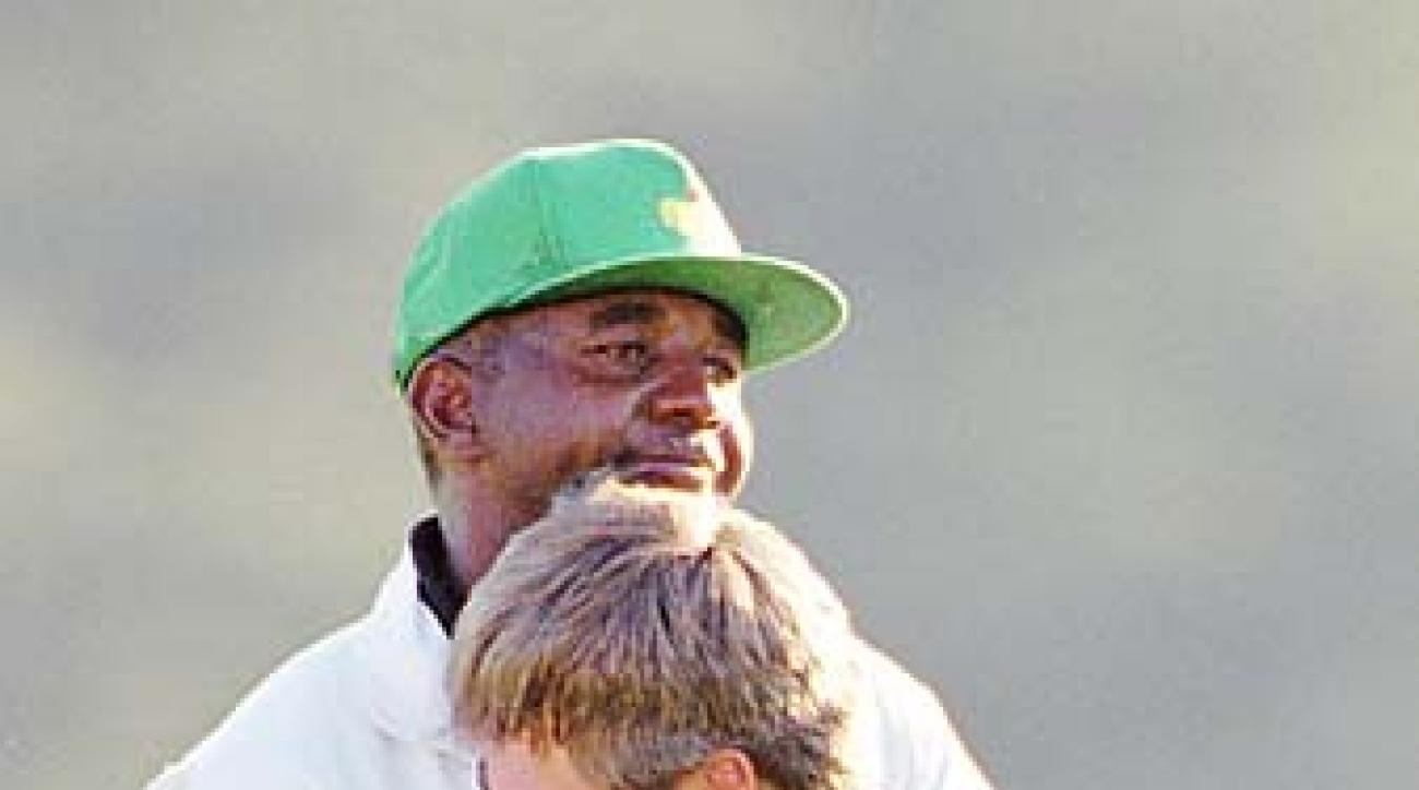 Ben Crenshaw hugs his caddie Carl Jackson after winning the 1995 Masters. Crenshaw and Jackson have written a new book titled 'Two Roads to Augusta.'