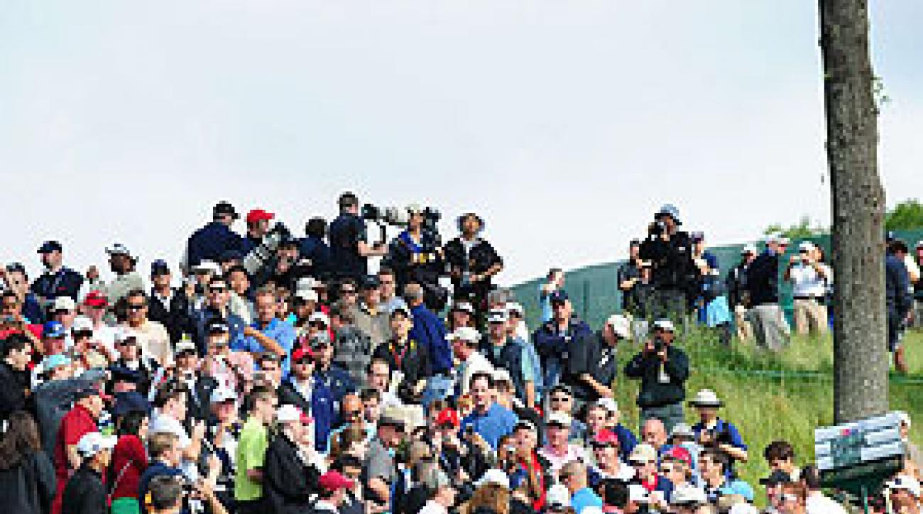 Crowds lined the fairways early to watch Tiger Woods play.