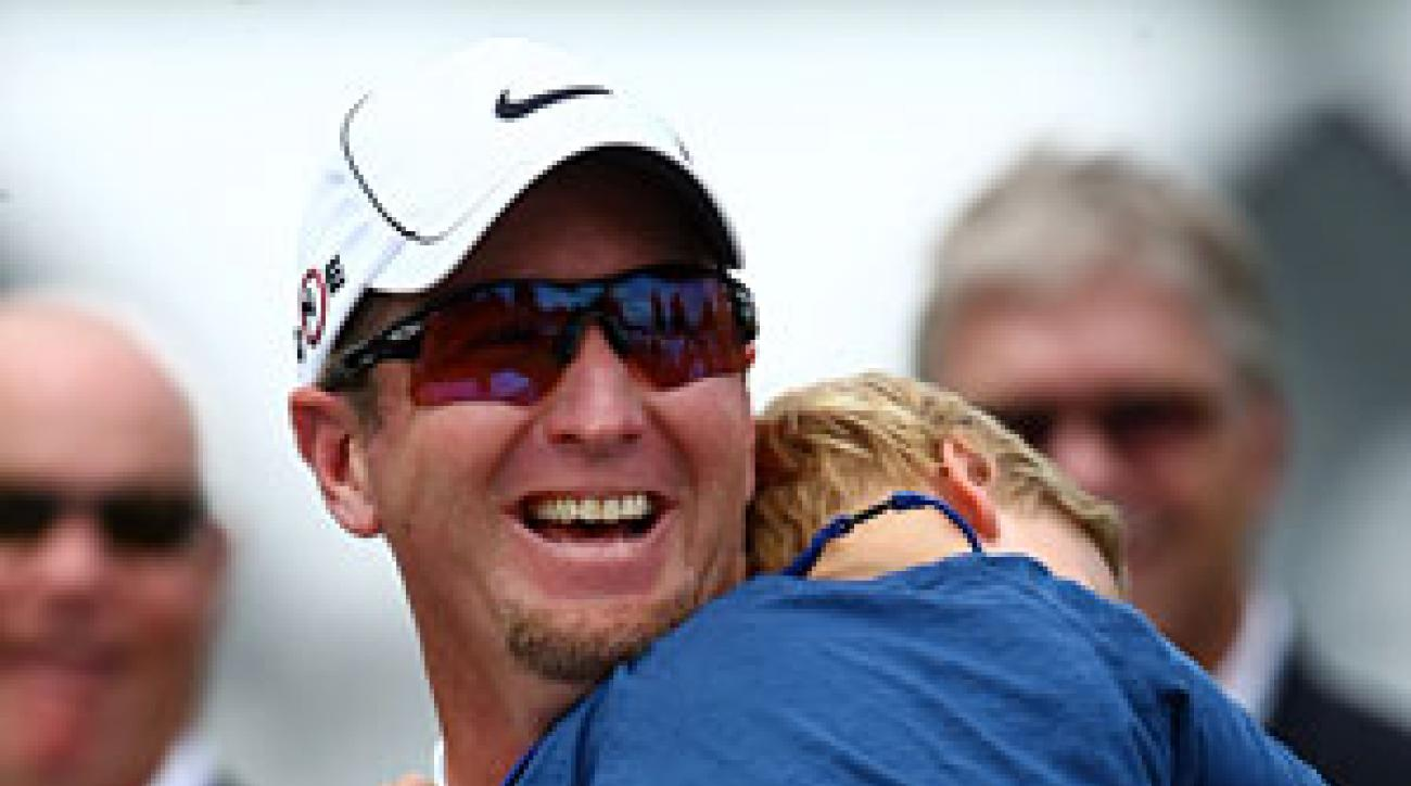 David Duval with his son at the trophy presentation ceremony at the 2009 U.S. Open at Bethpage Black.