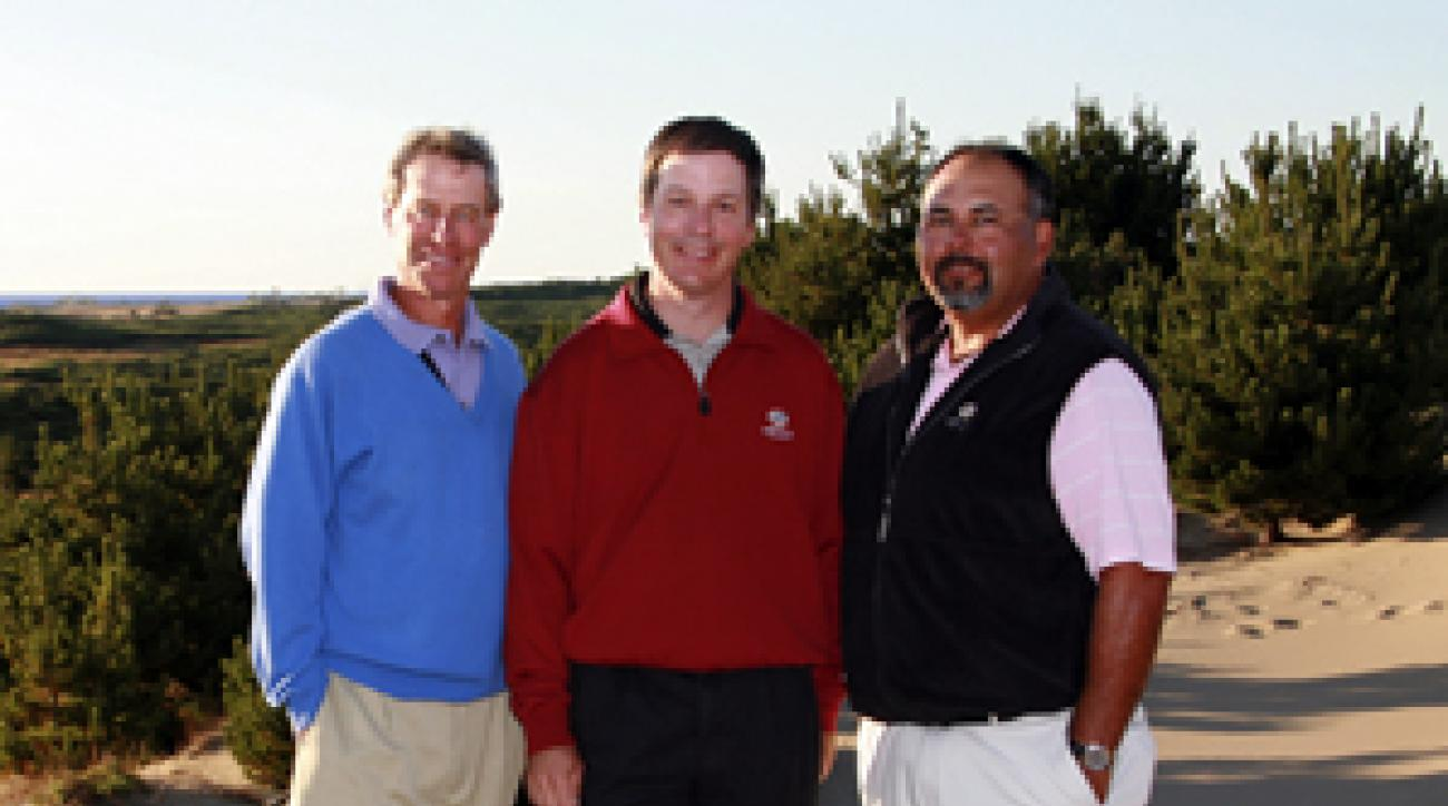 Doak (center) and Urbina (right) with Bandon Dunes creator Mike Keiser.