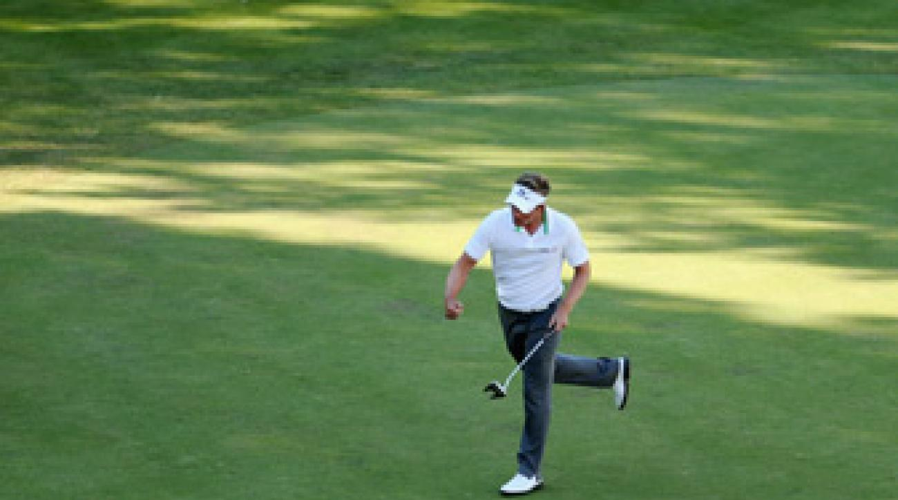 Luke Donald birdied the 18th to build a two-shot lead.