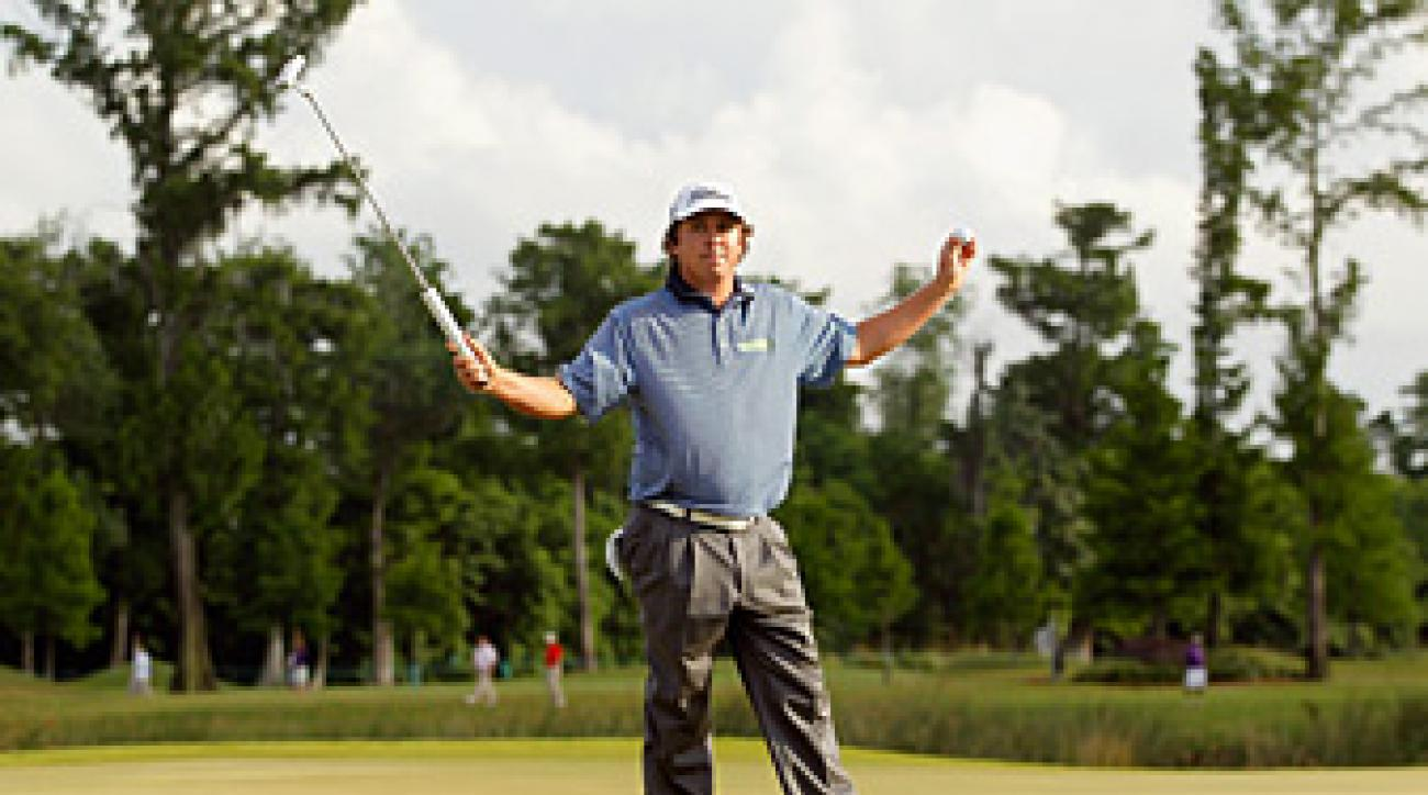 Jason Dufner defeated Ernie Els in a playoff to win his first PGA Tour title.