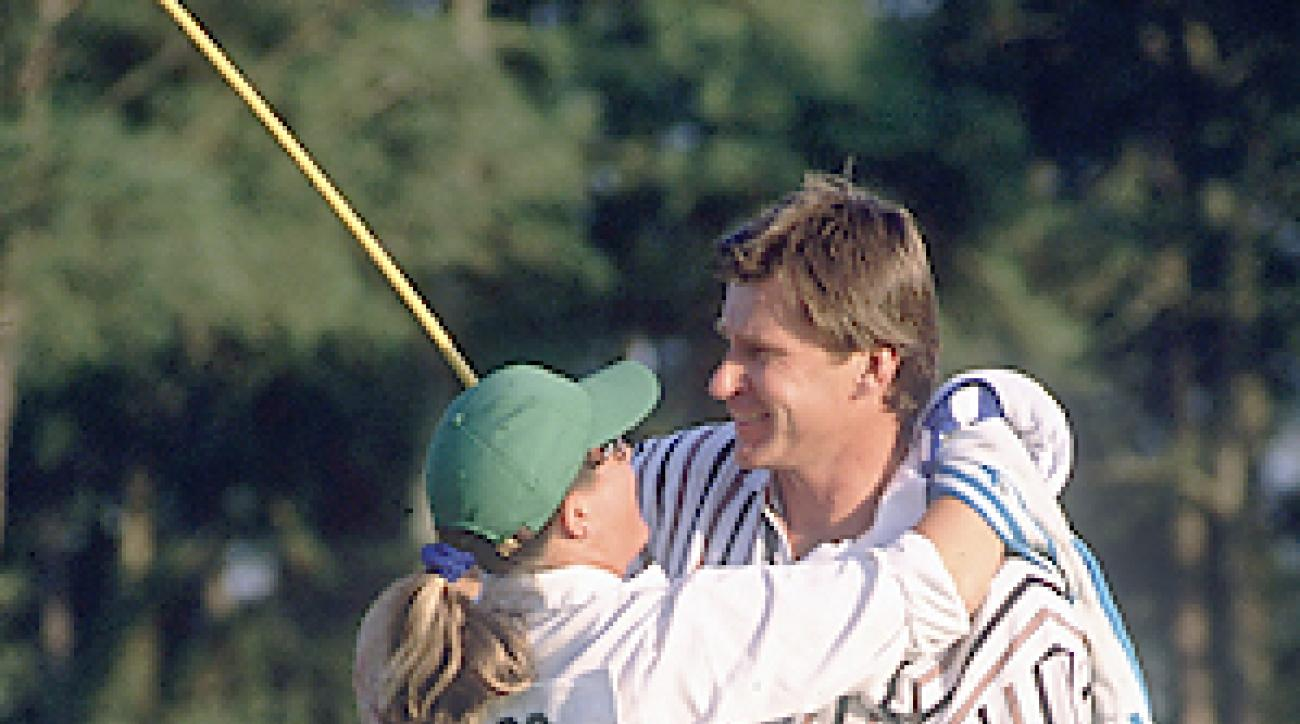 Faldo (with caddie Fanny Sunesson) won his final major championship at the 1996 Masters. It was his third green jacket.