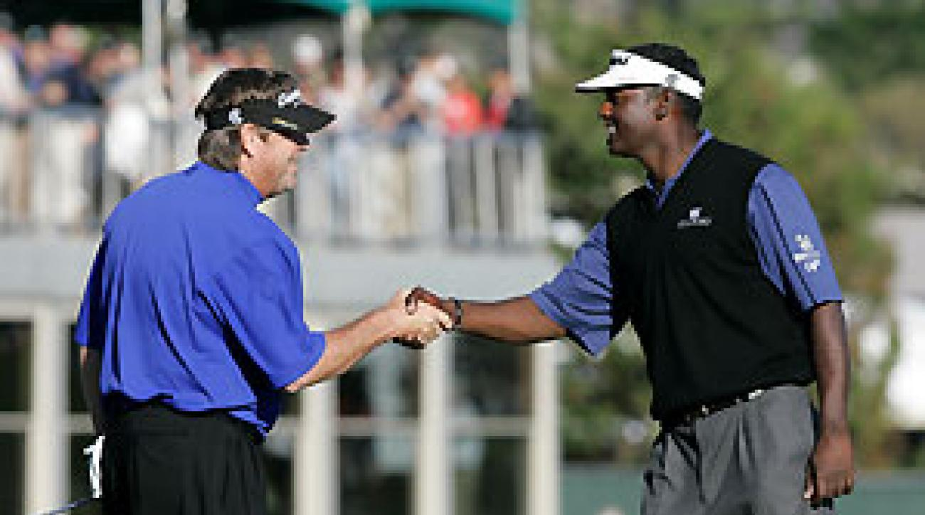 Steve Lowery, left, beat Vijay Singh in a playoff.